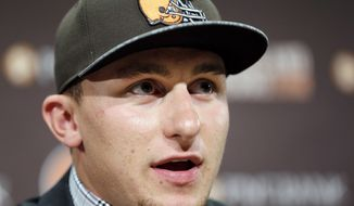 Cleveland Browns quarterback Johnny Manziel answers questions at his introductory news conference at the NFL football team's facility in Berea, Ohio, Friday, May 9, 2014. The Browns selected Manziel with the 22nd overall pick in the first round of the NFL draft. (AP Photo/Tony Dejak)