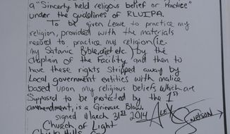This May 9, 2014, photo,shows the closing of a hand-written lawsuit filed by Alex C. Snelson, a Nevada inmate who practices Satanism and accuses the Washoe County jail of violating his right to freely exercise his religion. Snelson, 33, said in the amended complaint filed in U.S. District Court in Reno on Wednesday that he's been denied meals that adhere to his religious diet. (AP Photo/Scott Sonner).
