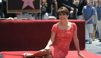 ** FILE ** In this May 22, 2012, file photo, actress Patricia Heaton poses on her new star during a Hollywood Walk of Fame induction ceremony in Los Angeles. (Photo by Chris Pizzello/Invision/AP, file)