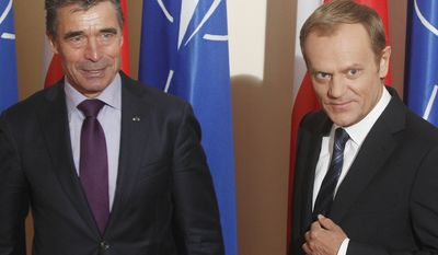 NATO Secretary General Anders Rasmussen ,left, meets with Poland's Prime Minister Donald Tusk at the Prime Minister's Office in Warsaw, Poland, Thursday, May 8, 2014. Rasmussen is in Poland for talks with the country's leaders.(AP Photo/Czarek Sokolowski)
