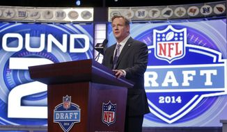 NFL commissioner Roger Goodell announces the opening of the second round of the 2014 NFL Draft, Friday, May 9, 2014, in New York. (AP Photo/Jason DeCrow)