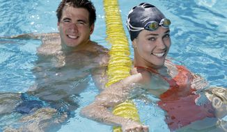 ADVANCE FOR WEKEND EDITIONS, MAY 10-11 - In this photo taken on Monday, May 5, 2014, U.S. Olympians Natalie Coughlin, right, and Nathan Adrian pose for a portrait at the University of California Berkeley in Berkeley, Calif. (AP Photo/Marcio Jose Sanchez)