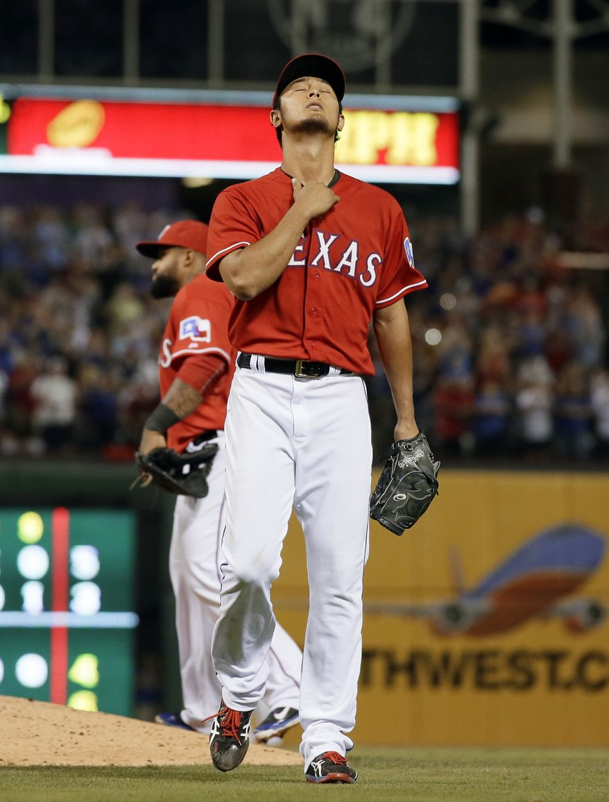 Texas Rangers' Yu Darvish of Japan walks off the field in the ninth inning of a baseball game against the Boston Red Sox, Friday, May 9, 2014, in Arlington, Texas. Darvish took a no-hit bid into 8 and 2/3 giving up a single to David Ortiz in the 8-0 Rangers win.  (AP Photo/Tony Gutierrez)