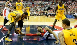 Washington Wizards guard John Wall (2) dives after he loses a ball in the third quarter as the Washington Wizards lose to the Indiana Pacers 85-63 in game 3 during the second round of the Eastern Conference Semifinal NBA basketball playoffs at the Verizon Center, Washington, D.C., Friday, May 9, 2014. (Andrew Harnik/The Washington Times)