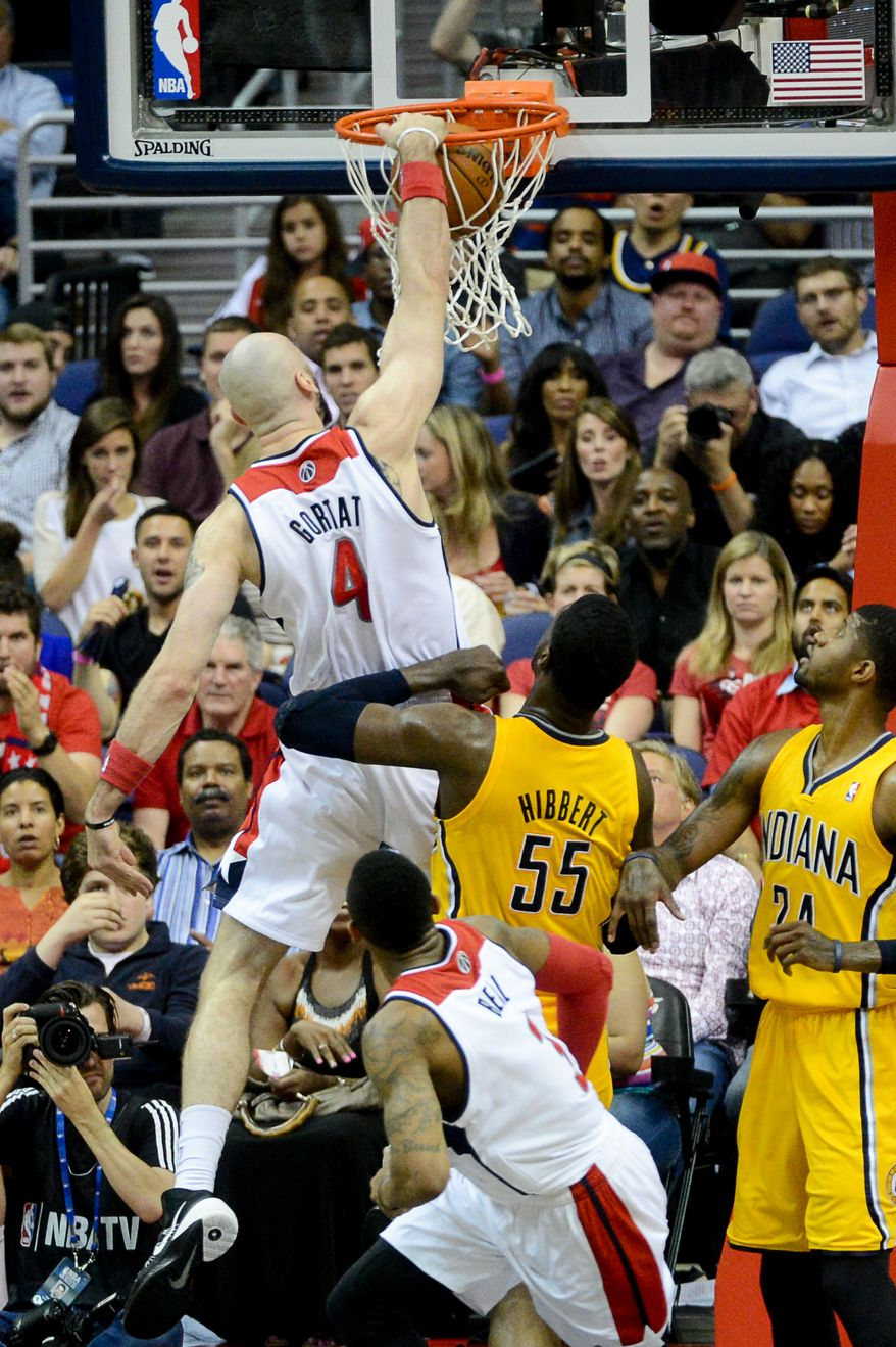 Washington Wizards center Marcin Gortat (4) dunks over Indiana Pacers center Roy Hibbert (55) early in the first quarter as the Washington Wizards lose to the Indiana Pacers 85-63 in game 3 during the second round of the Eastern Conference Semifinal NBA basketball playoffs at the Verizon Center, Washington, D.C., Friday, May 9, 2014. (Andrew Harnik/The Washington Times)