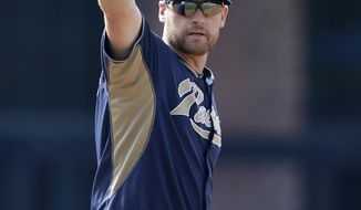 San Diego Padres third baseman Chase Headley gestures while fielding ground balls before playing the Miami Marlins in a baseball game on Saturday, May 10, 2014, in San Diego. Headley was reinstated Saturday, coming off the 15-day disabled list, after suffering a calf strain in April. (AP Photo/Gregory Bull)