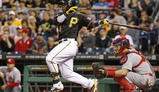 Pittsburgh Pirates' Josh Harrison (5) drives in a run with a single off St. Louis Cardinals starting pitcher Lance Lynn during the fourth inning of a baseball game in Pittsburgh, Saturday, May 10, 2014. (AP Photo/Gene J. Puskar)