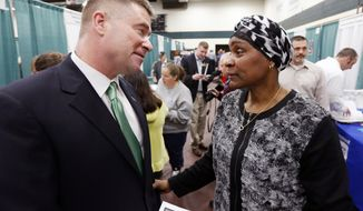 Rep. Chris Gibson, R-N.Y., talks with Sharon Cobbins of Hudson, N.Y., during a job fair his office co-hosted at Columbia-Greene Community College on Tuesday, April 22, 2014, in Hudson. He is running against Democrat Sean Eldridge, (AP Photo/Mike Groll)
