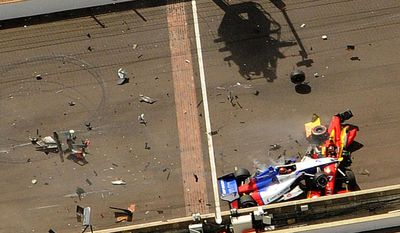 Mikhail Aleshin, of Russia, goes over the top of the car driven by Sebastian Saavedra, of Colombia, at the start of the inaugural Grand Prix of Indianapolis IndyCar auto race at the Indianapolis Motor Speedway in Indianapolis, Saturday, May 10, 2014.  (AP Photo/Indianapolis Star, Greg Griffo) NO SALES