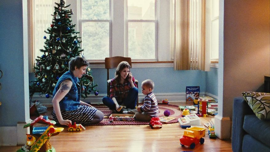 """This photo provided by courtesy of Magnolia Pictures shows, Lena Dunham, left, and Anna Kendrick, in a scene from the film, """"Happy Christmas,"""" a Magnolia Pictures release. (AP Photo/Magnolia Pictures)"""