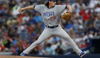 Chicago Cubs starting pitcher Jeff Samardzija (29) works in the first inning of a baseball game against the Atlanta Braves, Saturday, May 10, 2014, in Atlanta.  (AP Photo/John Bazemore)