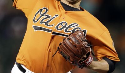 Baltimore Orioles relief pitcher Tommy Hunter throws to the Houston Astros in the ninth inning of a baseball game, Saturday, May 10, 2014, in Baltimore. (AP Photo/Patrick Semansky)