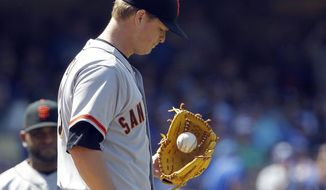 San Francisco Giants starting pitcher Matt Cain looks away after walking Los Angeles Dodgers' Hanley Ramirez in the sixth inning of a baseball game on Saturday, May 10, 2014, in Los Angeles. Cain was removed from the game after walking Ramirez. (AP Photo/Alex Gallardo)