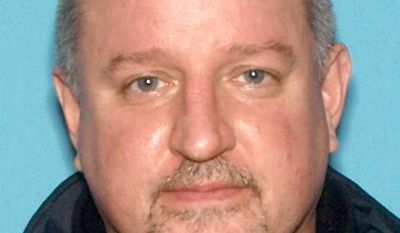 CORRECTS SOURCE TO LODI POLICE DEPARTMENT - John Robert Jordan is seen in an undated photo provided by the the the Lodi Police Department. Police say Jordan, 47,  fatally stabbed his estranged wife Tracy Jordan in Lodi, N.J., then fled to South Carolina with the couple's two sons. Police found Jordan dead of multiple stab wounds at her Lodi home Friday night. Authorities say Jordan was arrested early Saturday after arriving at a relative's home in Greenville, South Carolina, in Tracy Jordan's car. The couple's 7- and 8-year-old sons were found unharmed.  (AP Photo/Lodi Police Department)