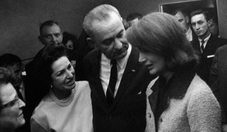 Lady Bird and Lyndon Johnson with Jackie Kennedy in the bloodied suit, moments after Johnson was administered the presidential oath. (AP Photo/White House/Cecil Stoughton, File)