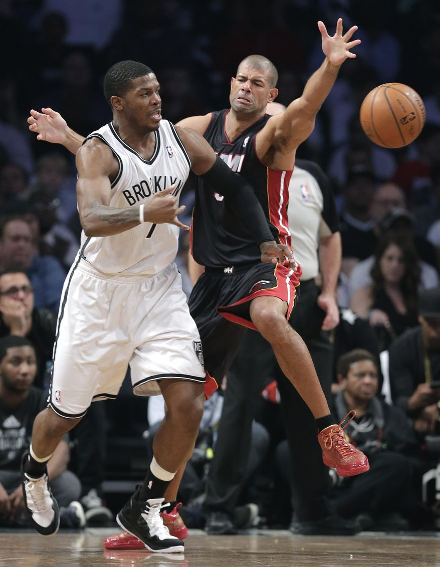 Brooklyn Nets guard Joe Johnson (7) passes the ball against Miami Heat forward Shane Battier in the second period during Game 3 of an Eastern Conference semifinal NBA playoff basketball game on Saturday, May 10, 2014, in New York. (AP Photo/Julie Jacobson)