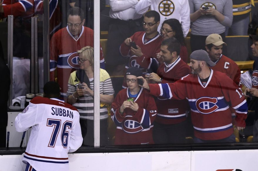 Montreal Canadiens fans photograph defenseman P.K. Subban (76) during a warmup before facing the Boston Bruins in Game 5 of the second-round of the Stanley Cup hockey playoff series in Boston, Saturday, May 10, 2014. (AP Photo/Charles Krupa)