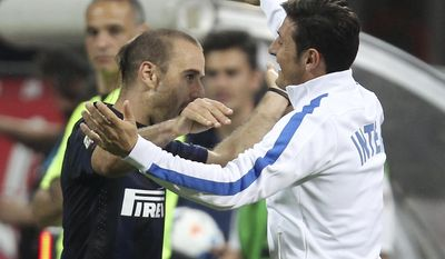 Inter Milan forward Rodrigo Palacio, left, of Argentina, celebrates with his teammate Argentine defender Javier Zanetti after scoring during the Serie A soccer match between Inter Milan and Lazio at the San Siro stadium in Milan, Italy, Saturday, May 10, 2014. (AP Photo/Antonio Calanni)
