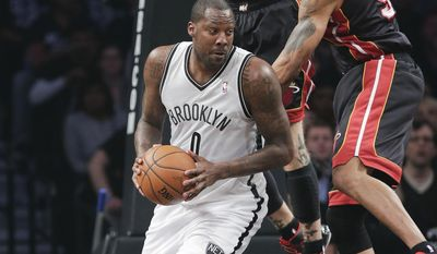 Miami Heat forward Rashard Lewis (9) and forward Chris Andersen (11) double-team Brooklyn Nets center Andray Blatche (0) in the first period during Game 3 of an Eastern Conference semifinal NBA playoff basketball game on Saturday, May 10, 2014, in New York. (AP Photo/Julie Jacobson)