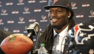 Houston Texans No. 1 overall NFL draft pick defensive end Jadeveon Clowney smiles during an introductory NFL football news conference Friday, May 9, 2014, in Houston. (AP Photo/Pat Sullivan)