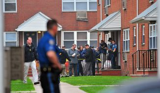 In this May 9, 2014 photo, police investigating the scene in Lodi, N.J. State police said a mother of two boys who went missing Friday, was found stabbed to death. State police say Amber Alert for the boys ages 7 and 8 was canceled early Saturday after they were recovered safe in South Carolina. (AP Photo/Northjersey.com, Marko Georgiev) ONLINE OUT; MAGS OUT; TV OUT; INTERNET OUT;  NO ARCHIVING; MANDATORY CREDIT