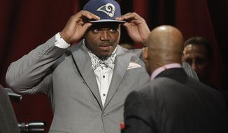 Auburn tackle Greg Robinsondons a St. Louis Rams cap after being chosen by Rams as the second pick in the first round of the 2014 NFL Draft, Thursday, May 8, 2014, in New York. (AP Photo/Frank Franklin II)