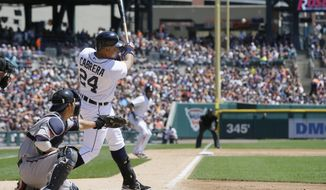 Detroit Tigers' Miguel Cabrera connects for a 3-run home run during the second inning of a baseball game against the Minnesota Twins in Detroit, Saturday, May 10, 2014. (AP Photo/Carlos Osorio)