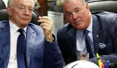 Dallas Cowboys owner and general manager Jerry Jones,left, and son, team executive vice president Stephen Jones watch the NFL's draft show at the Dallas Cowboys war room at Valley Ranch Thursday May 8, 2014, Irving, Texas. (AP Photo/The Fort Worth Star-Telegram, Ron Jenkins)    MAGS OUT; (FORT WORTH WEEKLY, 360 WEST); INTERNET OUT