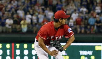 Texas Rangers' Yu Darvish of Japan watches a single by Boston Red Sox's David Ortiz reach outfielder Alex Rios in the ninth inning of a baseball game spoiling a no-hit bid by Darvish, Friday, May 9, 2014, in Arlington, Texas. The Rangers won 8-0. (AP Photo/Tony Gutierrez)