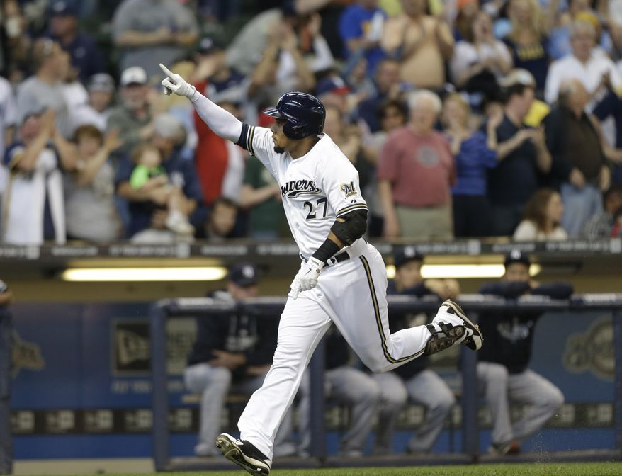 Milwaukee Brewers' Carlos Gomez reacts after his home run against the New York Yankees in the first inning of a baseball game Saturday, May 10, 2014, in Milwaukee. (AP Photo/Jeffrey Phelps)