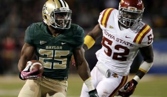 Baylor 's Lache Seastrunk (25) runs the ball as Iowa State 's Jeremiah George (52) gives chase in the first half of an NCAA college football game, Saturday, Oct. 19, 2013, in Waco, Texas. (AP Photo/Tony Gutierrez)