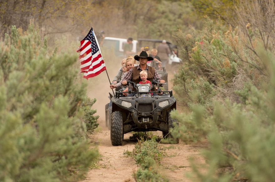 Ryan Bundy, son of the Nevada rancher Cliven Bundy, rides an ATV into Recapture Canyon north of Blanding, Utah, on Saturday, May 10, 2014, in a protest against what demonstrators call the federal government's overreaching control of public lands. (AP Photo/The Salt Lake Tribune, Trent Nelson) ** FILE **