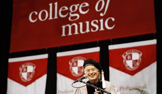 Former Led Zeppelin guitarist Jimmy Page smiles as he speaks during the commencement of the Berklee College of Music in Boston, Saturday, May 10. 2014. (AP Photo/Winslow Townson)