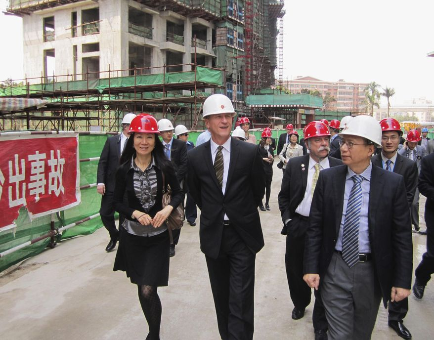 This March 2012 photo provided by Gov. Dennis Daugaard's office shows South Dakota Gov. Dennis Daugaard, center, walking with Chinese representatives during the governor's first trade mission to China. Daugaard will be joined by representatives from 11 companies and groups from around South Dakota when he makes his third trade mission to China May 9-16, 2014. (AP Photo/Courtesy of Gov. Dennis Daugaard's Office)
