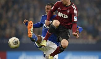 Nuremberg's Josip Drmic of Switzerland , right, and Schalke's Joel Matip of Cameroon challenge for the ball during the German Bundesliga soccer match between FC Schalke 04 and 1. FC Nuremberg in Gelsenkirchen,  Germany, Saturday, May 10, 2014. (AP Photo/Martin Meissner)