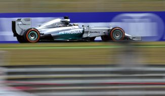 Mercedes driver Lewis Hamilton of Britain steers his car during the third free practice ahead of the Spain Formula One Grand Prix at the Barcelona Catalunya racetrack in Montmelo, near Barcelona, Spain, Saturday, May 10, 2014.  (AP Photo/Manu Fernandez)
