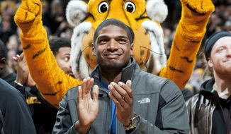 ** FILE ** In this Feb. 15, 2014, file photo, Missouri's All-American defensive end Michael Sam claps during the Cotton Bowl trophy presentation at halftime of an NCAA college basketball game between Missouri and Tennessee in Columbia, Mo. Sam was selected in the seventh round, 249th overall, by the St. Louis Rams in the NFL draft Saturday, May 10, 2014. The Southeastern Conference defensive player of the year last season for Missouri came out as gay in media interviews this year. (AP Photo/L.G. Patterson, File)
