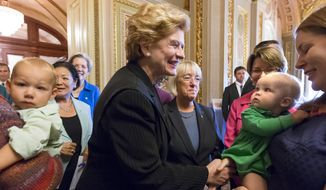 "In this Sept. 25, 2013, file photo, Sen. Debbie Stabenow, D-Mich., center, and Sen. Patty Murray, D-Wash., center right, and other Democratic lawmakers joined new mothers and their babies at the Capitol to criticize Republican efforts to kill the Affordable Care Act, popularly known as ""Obamacare,"" in Washington. (AP Photo/J. Scott Applewhite, File)"