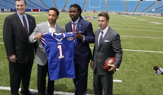 Buffalo Bills first round draft pick Sammy Watkins, second from right, poses for photos, from left, with head coach Doug Marrone, general manager Doug Whaley and president/CEO Russ Brandon at Ralph Wilson Stadium in Orchard Park, N.Y., Friday, May 9, 2014.  (AP Photo/The Buffalo News, John Hickey) TV OUT; MAGS OUT; MANDATORY CREDIT; BATAVIA DAILY NEWS OUT; DUNKIRK OBSERVER OUT; JAMESTOWN POST-JOURNAL OUT; LOCKPORT UNION-SUN JOURNAL OUT; NIAGARA GAZETTE OUT; OLEAN TIMES-HERALD OUT; SALAMANCA PRESS OUT; TONAWANDA NEWS OUT