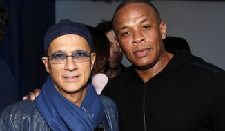 FILE - This Feb. 10, 2013 file photo shows music industry entrepreneur Jimmy Iovine, left, and hip-hop mogul Dr. Dre at a Grammy Party in Los Angeles. It's as if anything Iovine and Dre touches turns to gold: The dynamic duo marked epic-level success when they introduced Eminem to the music world 15 years ago, and their lucrative Beats by Dre business reached blockbuster heights following reports on Thursday, May 8, 2014, that Apple plans to by the headphone's parent company, Beats Electronics, for $3.2 billion.  (Photo by Todd Williamson/Invision/AP, file)
