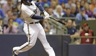 Milwaukee Brewers' Rickie Weeks hits a run-scoring single against the New York Yankees in the seventh inning of a baseball game Saturday, May 10, 2014, in Milwaukee. (AP Photo/Jeffrey Phelps)