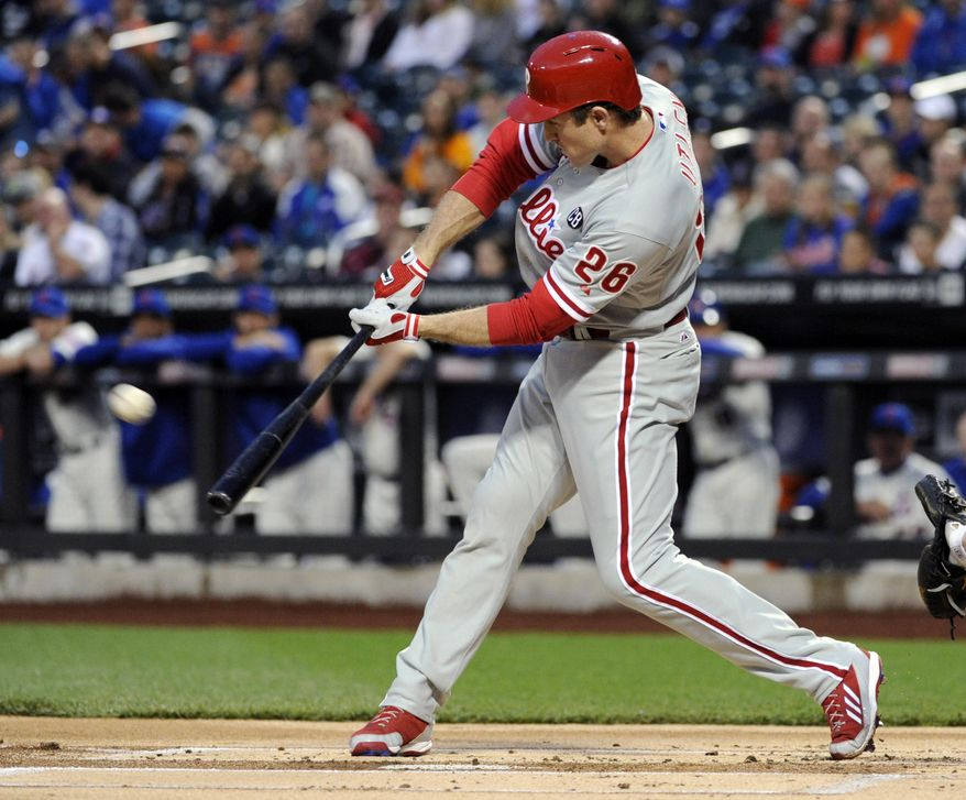 Philadelphia Phillies' Chase Utley hits a sacrifice fly to score Ben Revere during the first inning of a baseball game against the Ne York Mets, Saturday, May 10, 2014, at Citi Field in New York. (AP Photo/Bill Kostroun)