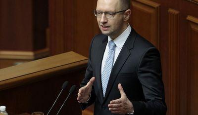 ** FILE ** In this April 29, 2014, file photo, Ukrainian Prime Minister, Arseniy Yatsenyuk, speaks to lawmakers during a session at the Ukrainian parliament in Kiev. (AP Photo/Sergei Chuzavkov, File)