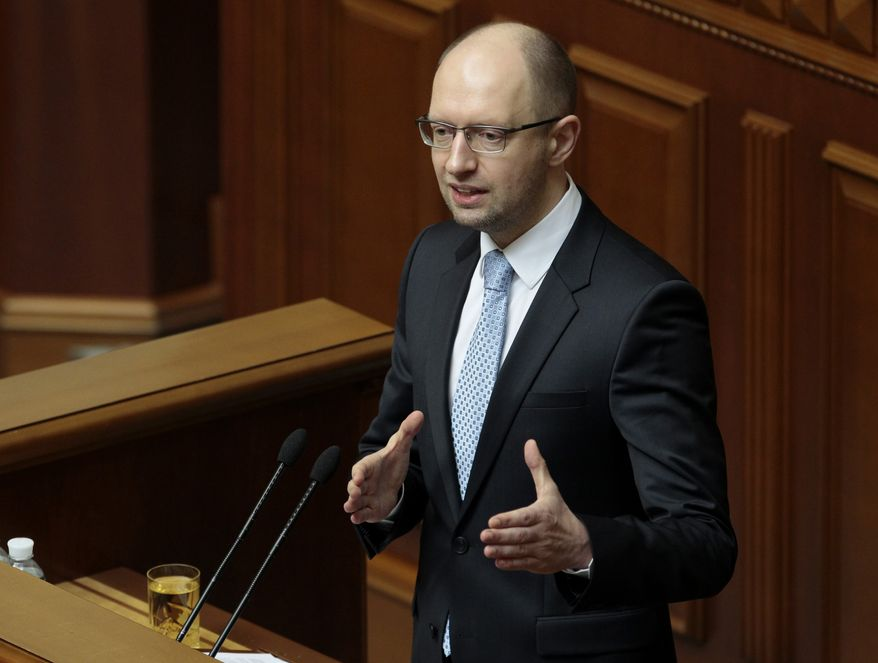 ** FILE ** In this April 29, 2014, file photo, Ukrainian Prime Minister, Arseniy Yatsenyuk, speaks to lawmakers during a session at the Ukrainian parliament in Kiev. (AP Photo/Sergei Chuzavkov, File)