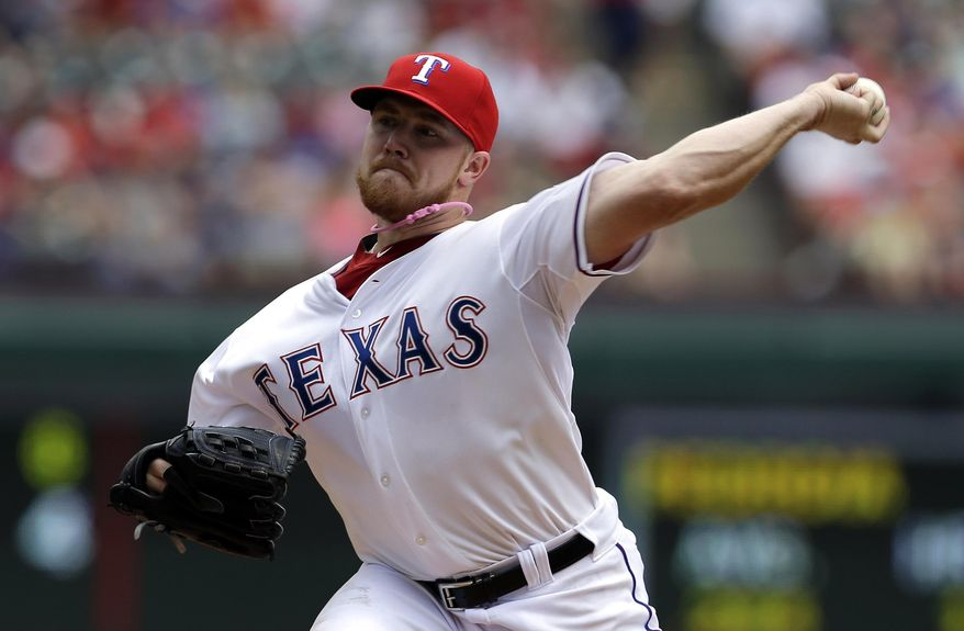 Texas Rangers' Robbie Ross works against the Boston Red Sox in the first inning of a baseball game on Sunday, May 11, 2014, in Arlington, Texas. (AP Photo/Tony Gutierrez)