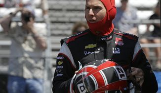 Will Power, of Australia, prepares to drive during practice for Indianapolis 500 IndyCar auto race at the Indianapolis Motor Speedway in Indianapolis, Sunday, May 11, 2014. (AP Photo/Darron Cummings)