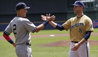 New York Yankees Derek Jeter greets Milwaukee Brewers' Ryan Braun  before their game against the Milwaukee Brewers Sunday, May 11, 2014, in Milwaukee. It will be Jeter's last game at Miller park. (AP Photo/Jeffrey Phelps)