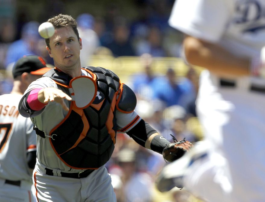 San Francisco Giants catcher Buster Posey throws out Los Angeles Dodgers' Clayton Kershaw on a sacrifice bunt in the third inning of a baseball game on Sunday, May 11, 2014, in Los Angeles. (AP Photo/Alex Gallardo)