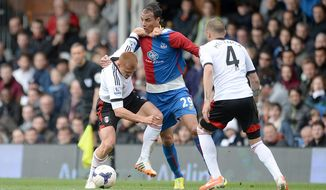 Tempers flare between Fulham's Steve Sidwell, left, and Crystal Palace's Marouane Chamakh, center, as they battle for the ball during their English Premier League soccer match at Craven Cottage, London,  Sunday, May 11, 2014. (AP Photo/Anthony Devlin, PA Wire)    UNITED KINGDOM OUT   -   NO SALES   -   NO ARCHIVES