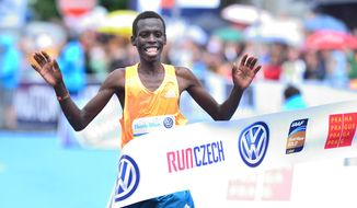 Patrick Terer of Kenya crosses the finish line to win the 20th Prague International Marathon in Prague, Czech Republic, on Sunday, May 11, 2014. (AP Photo/CTK, Vit Simanek) SLOVAKIA OUT